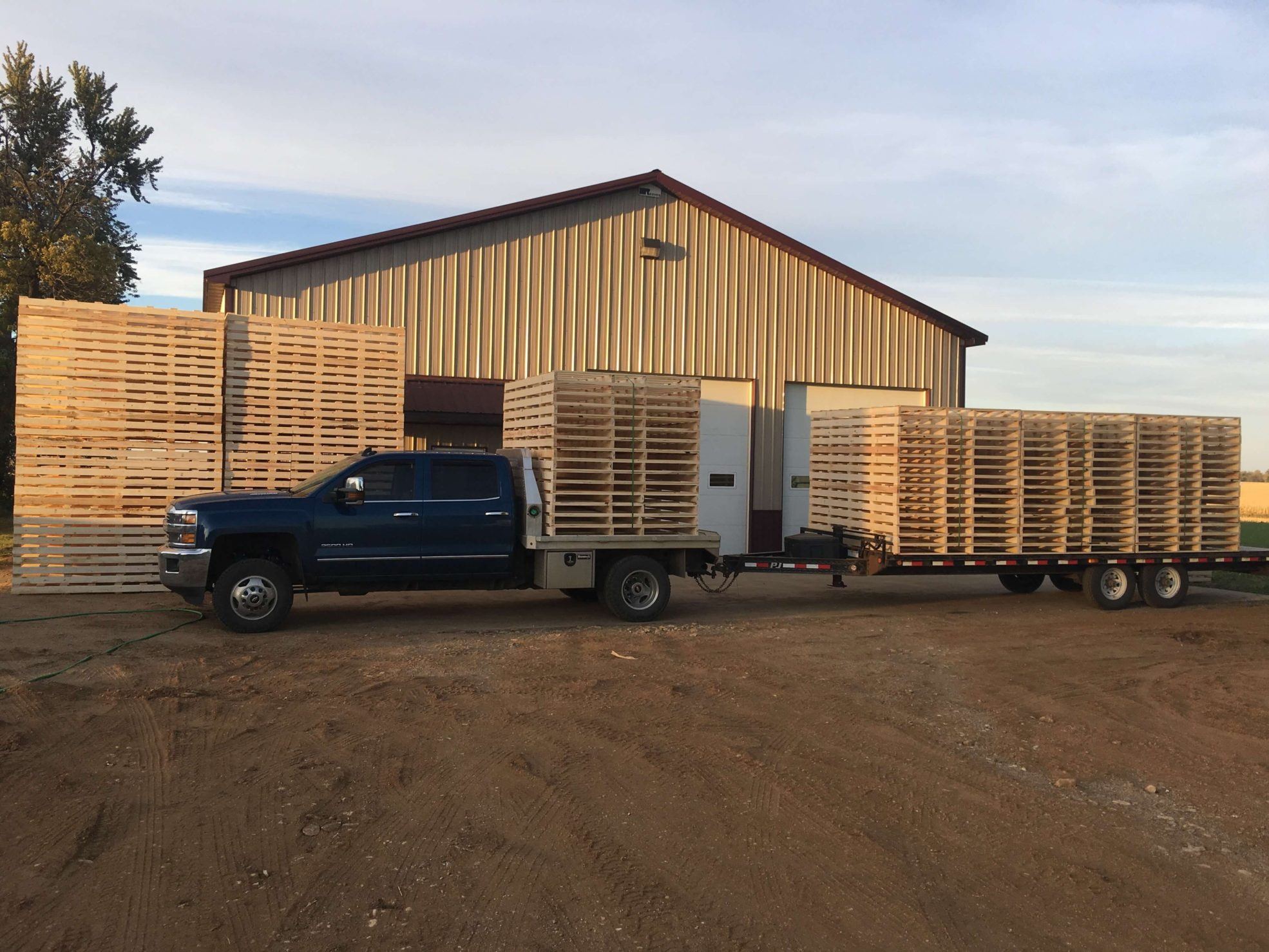 Rienk Inc. provides quality, custom pallets to the Northwest Iowa region. Including delivering pallets with Truck & Trailer